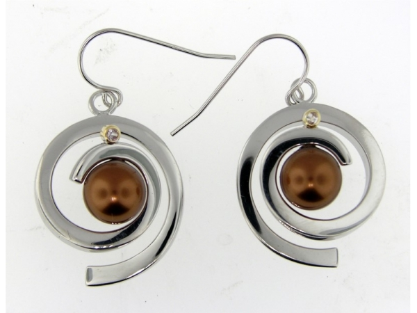 Earrings by Frank Reubel